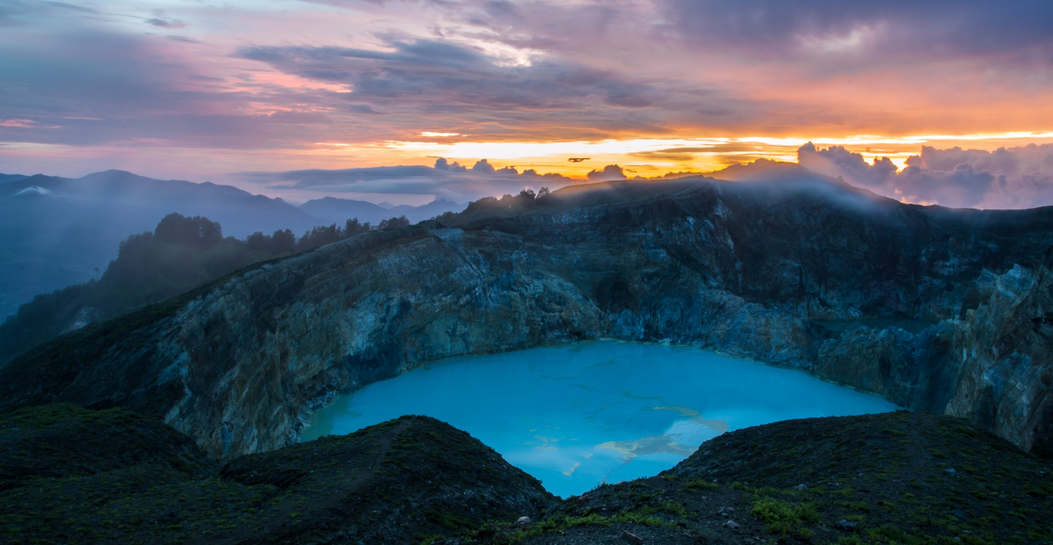 At the top of the Indonesian volcano Kelimutu situated three lakes, each lake periodically changes its color because of volcanic gases - Serious Facts