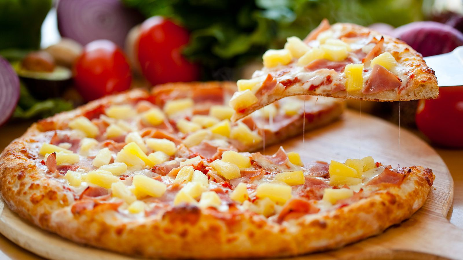 The Hawaiian Pizza was invented by Sam Panopoulos in Canada & now it is most popular in Australia.