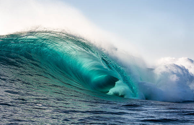 Tsunamis can travel through whole oceans with partial energy loss.