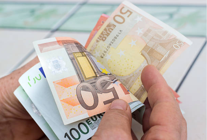Some countries share a currency. For example, countries in Europe all use the Euro.