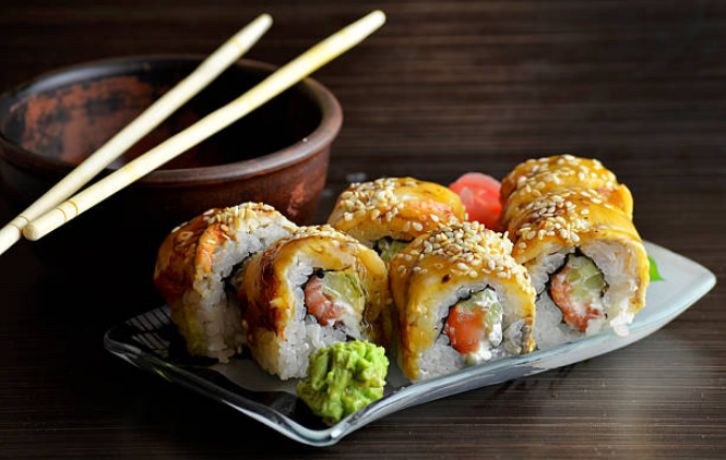 Sushi is traditionally eaten with the fingers, although many people use chopsticks.