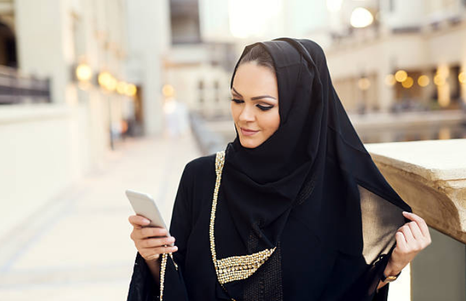 The black abaya is the Saudi national dress for women.
